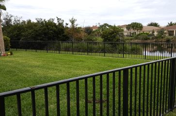 We install ornamental steel and aluminum fences that have the look and feel of wrought iron. Get the security you're looking for while also adding lots of curb appeal and value to your property. Wrought iron fencing is typically more expensive than other fence materials due to the time it takes to install properly and the cost of the product.