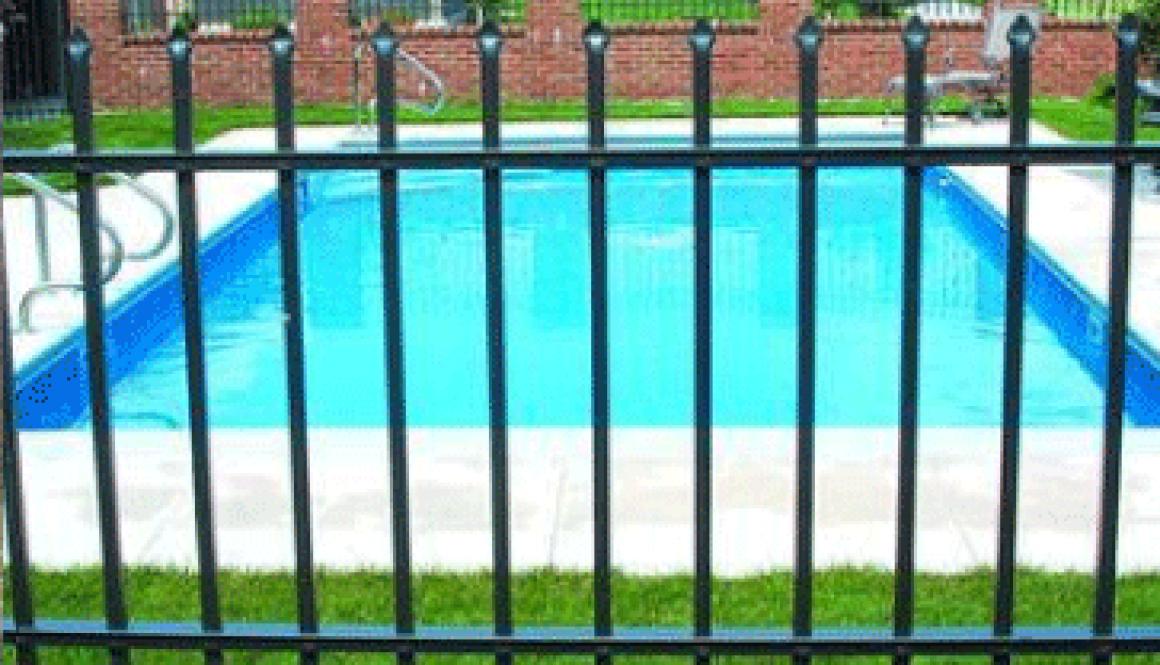 aluminum-pool-fence-on-brick-around-a-pool