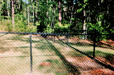 Chain link fence Redding Ca is one of the most popular fence types in the Redding CA area. Its affordable and durable and comes in many styles and colors. Add more security to your property today with a chain ink fence!