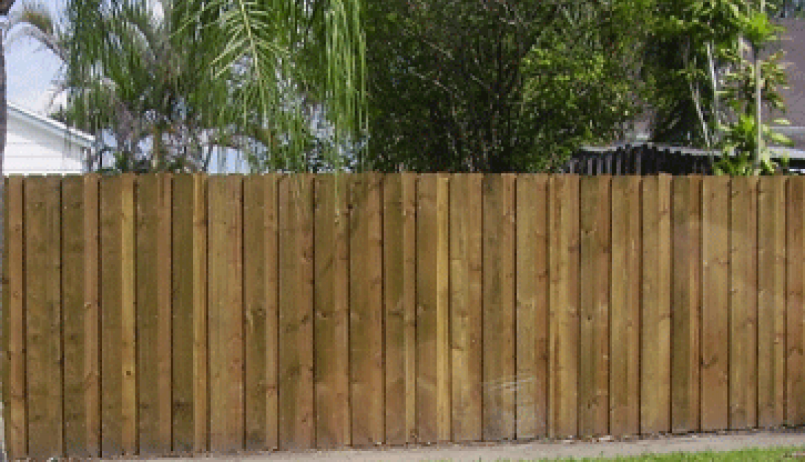 wood-fence-natural-stain-giving-privacy-and-security-to-residential-property