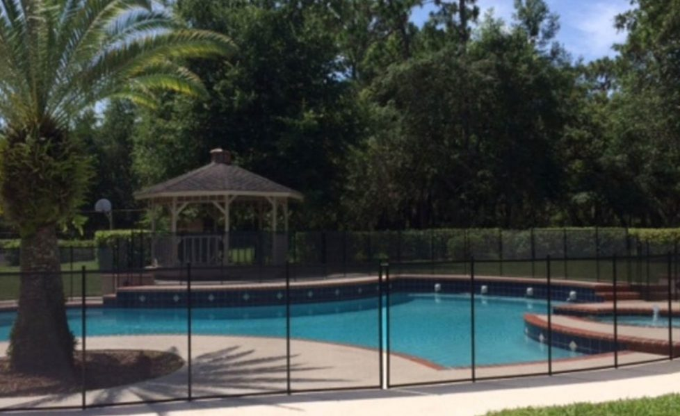 pool fence miami fl - chain link around pool of nice backyard-15